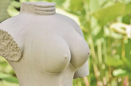 Beautiful bosom on stone sculpture photo