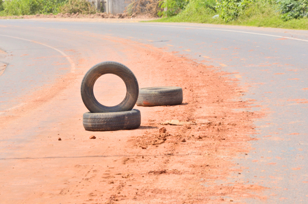 drawback: Dangerous warning tires on the road Stock Photo