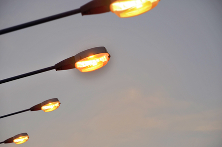 envisage: The lamps on evening sky Stock Photo