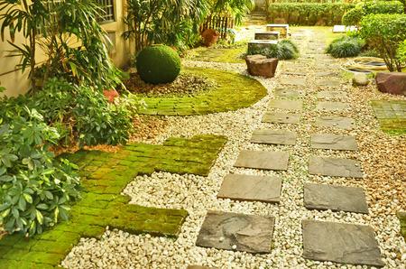 Sand stone pathway in the garden photo
