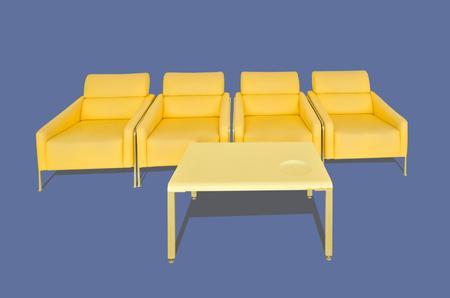 hassock: Yellow sofa on blue background