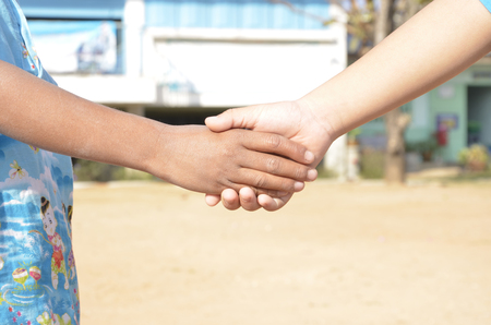 Shake hands for friendship Stock Photo - 25673322