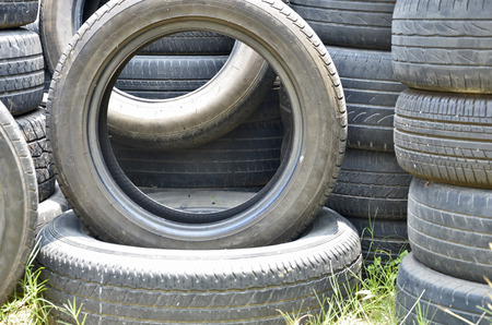 Old black tires and the grass photo