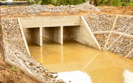 culvert: New concrete culvert for water drain Stock Photo