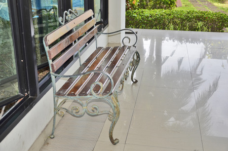 Iron seat beside the garden photo