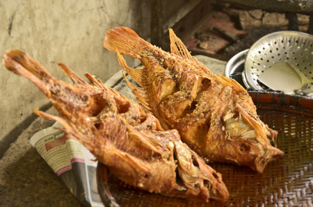 Fried tilapia fish in bamboo grill photo