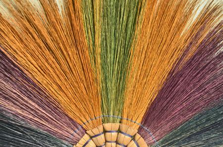 scuff: Color grass branches of a broom