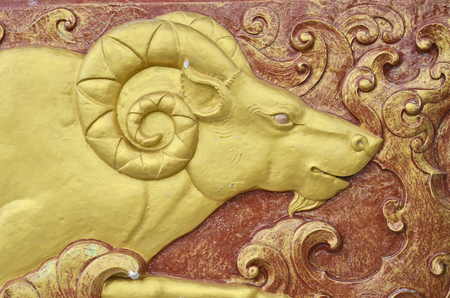 low relief:  Gold goat sculpture low relief Stock Photo