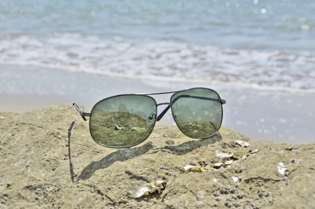 Sun glasses on the rock photo