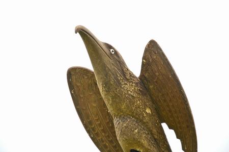salient: Gold wood eagle on white background