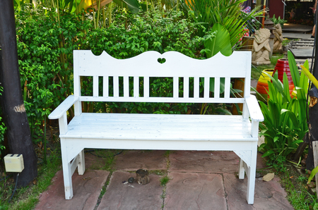 White seat in the garden photo