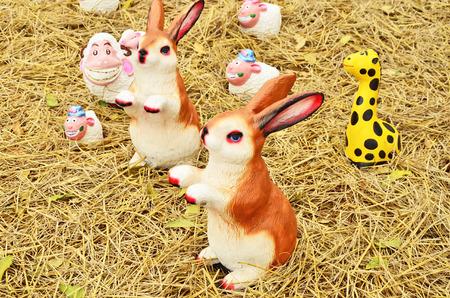 Animal sculpture on straw floor photo