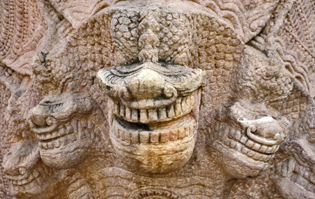 sand stone: Monster faces on sand stone Stock Photo