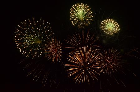 Color fire crackers in dark sky Stock Photo