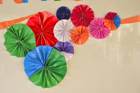 rend: Color paper flowers on white background