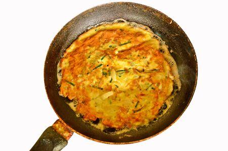 omlet: Yellow omlet in black pan Stock Photo