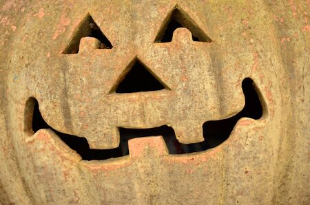 ghost face: Ghost face on baked clay pumpkin