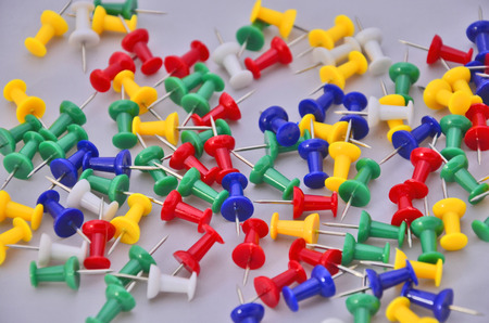Color pegs on white floor Stock Photo