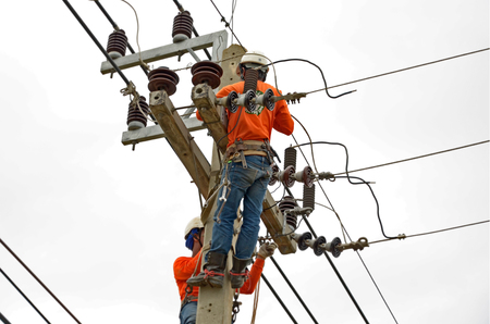 lineman: Working electricians on the top pole