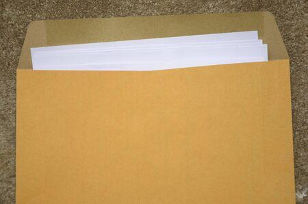 tabular: White paper in brown bag