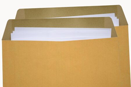 tabular: Brown envelopes with white paper