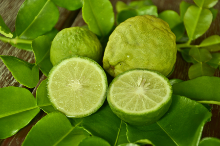 Bergamot fruits with green leaves closeup