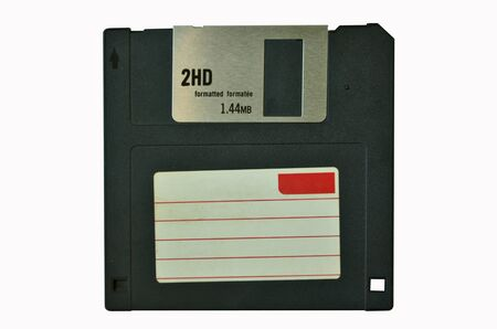 the outmoded: Black floppy disk on white background