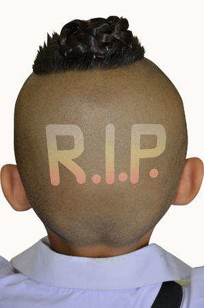 implore: Rest in peace sign on skin head Stock Photo