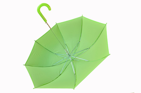 upturned: Beautiful green umbrella on white background Stock Photo