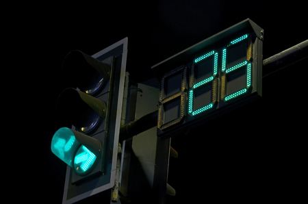 count down: Count down watch and green light traffic sign in the night