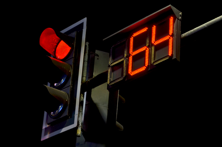 count down: Count down watch and red light traffic sign in the night Stock Photo