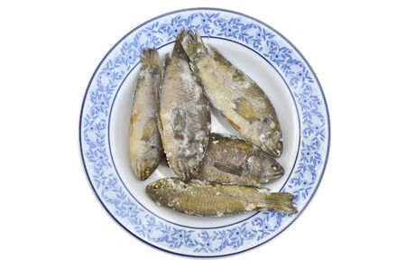 parch: Fried salt climbing perch fish in the ceramic plate