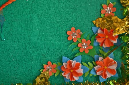 rive: Paper flower ornament on the board corner
