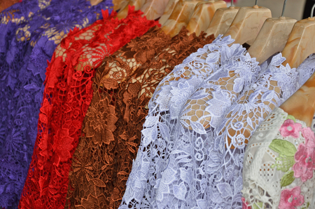blouses: Beautiful lace blouses with clothes hangers Stock Photo