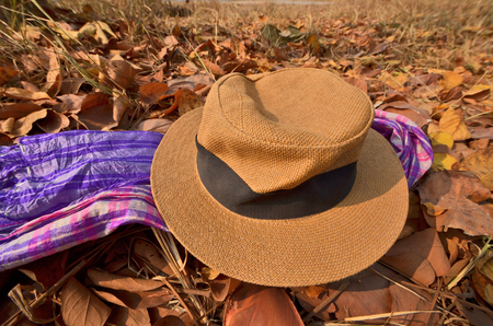 multipurpose: A hat and multipurpose clothes on dried leaves