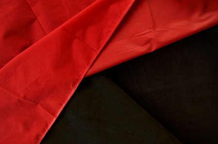 friso: la textura de color rojo y negro de la ropa del friso Foto de archivo