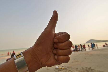 liked: Liked hand symbol on beach scene