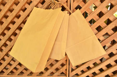 Three paper bags on lath wall Stock Photo