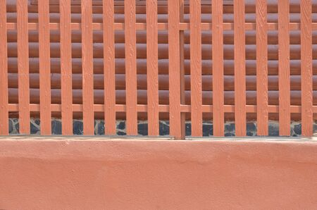 lath in modern: Brown fence and brown house wall Stock Photo