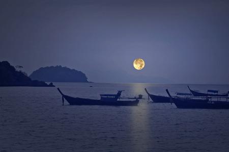 Romantic full moon night over smooth sea Stock Photo