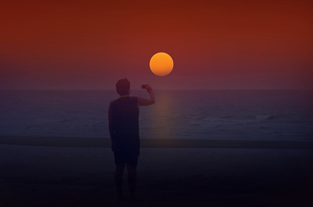 lurid: Photography tourist with sun rise over the sea