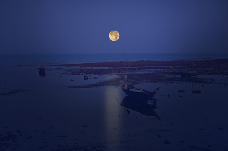 lurid: Blue sea with the boats and full moon Stock Photo
