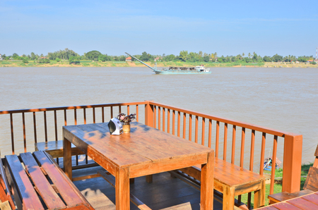 Outdoor table and seats on terrace and river view