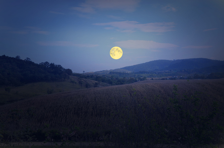 Beautiful full moon over the mountain in winter