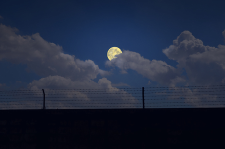 float cotton cloud: Full moon and white coulds over the wall Stock Photo
