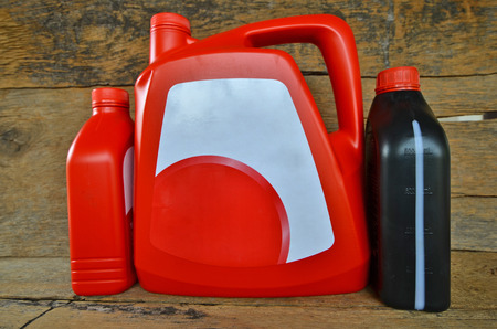 gallons: Red and black gallons of motor oil Stock Photo