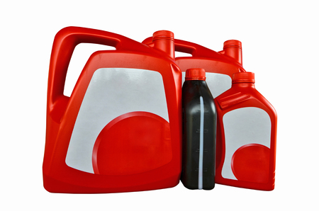 gallons: Red and black gallons with white label of motor oil Stock Photo