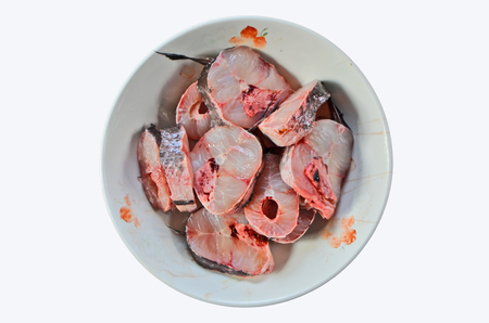 striped snakehead fish: Fresh raw parts of snakehead fish in a plate