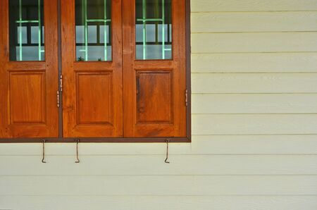 residence: Wooden and glass leaves of window at the wall