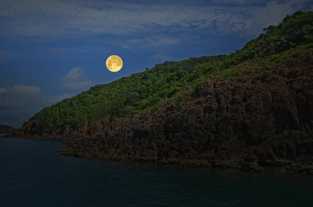 Romantic full moon over the island and the sea